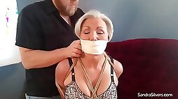 Milf bound and gagged in girdle