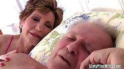 Old bimbo getting fucked while her man sleeps