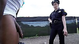 Female police officers having a 3some with a bbc over their patrol car