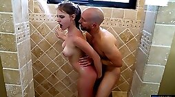 Busty girl welcomes step daddy in the shower with her