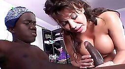 Busty brunette with nice ass gets a cunnilingus from the midget