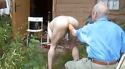 He fists her ass outdoors