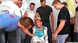 Adrenalized cougar with big titties weathers a no joke gangbang from a sexually starved crowd