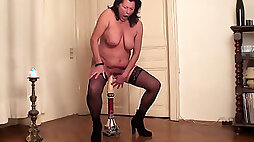 Damn ugly brunette cougar in stockings rides huge dildo and groans madly
