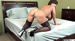 Milf boobs are big and glorious in a solo toy fucking show
