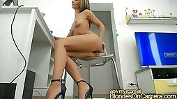 Blonde in high heels shows her ass at home