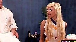 Beautiful blonde cheerleader with sprained ankle is totally into riding dick