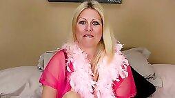 Ravishing blonde MILF with huge tits rubs her wet cunt