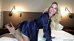Solo model Jessica Drake in high heels riding a large dildo
