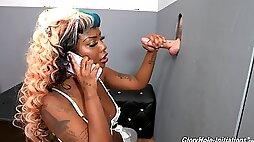 Ebony MILF in gloryhole supreme while talking on the phone