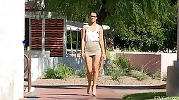 Alannah flashes her tits and shaved pussy in a park