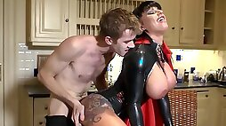 Skinny guy fucks his curvy wife in latex on the kitchen table