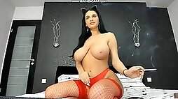 Busty brunette jessica smoking in sexy red fishnets and showing monster boobs