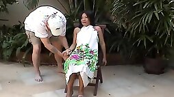 A master ties up his Asian slave, gags her and tortures her